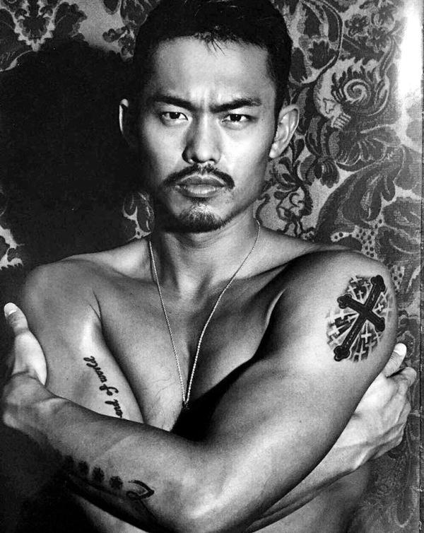 China's badminton champ Lin Dan puts his extensive tattoo collection on display in his 2014 photography book.