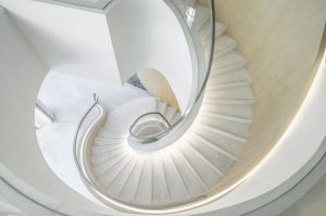 """PAL Design Group took 'online living' as their major inspiration for the Yongjia Sales Centre, designing four show flats for UNStudio's vertical living pods in Wenzhou, China. Lead designer Joey Ho (Design Partner at PAL) used modernist curves and a neutral colour palette to appeal to young millennial families living in the information age. """"Our design focus is minimalism while the promise of comfort is simply essential. The whole idea is about bringing design to the purest of our new 'online' living situations,"""" says the PAL team."""