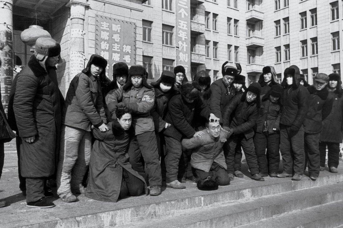 "A rebel group forced the leaders of a rival group to kneel and be criticized outside Harbin's North Plaza Hotel on Jan. 17, 1967. The steps were the site of numerous ""struggle sessions."" Credits: Li Zhensheng