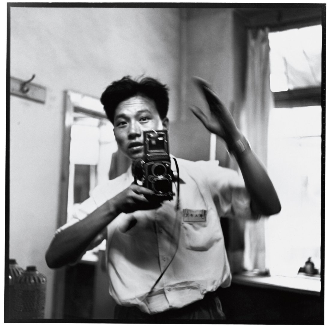 Li Zhensheng in a risky self portrait taken during China's Cultural Revolution on July 17, 1967, when people were expected to put party before self.